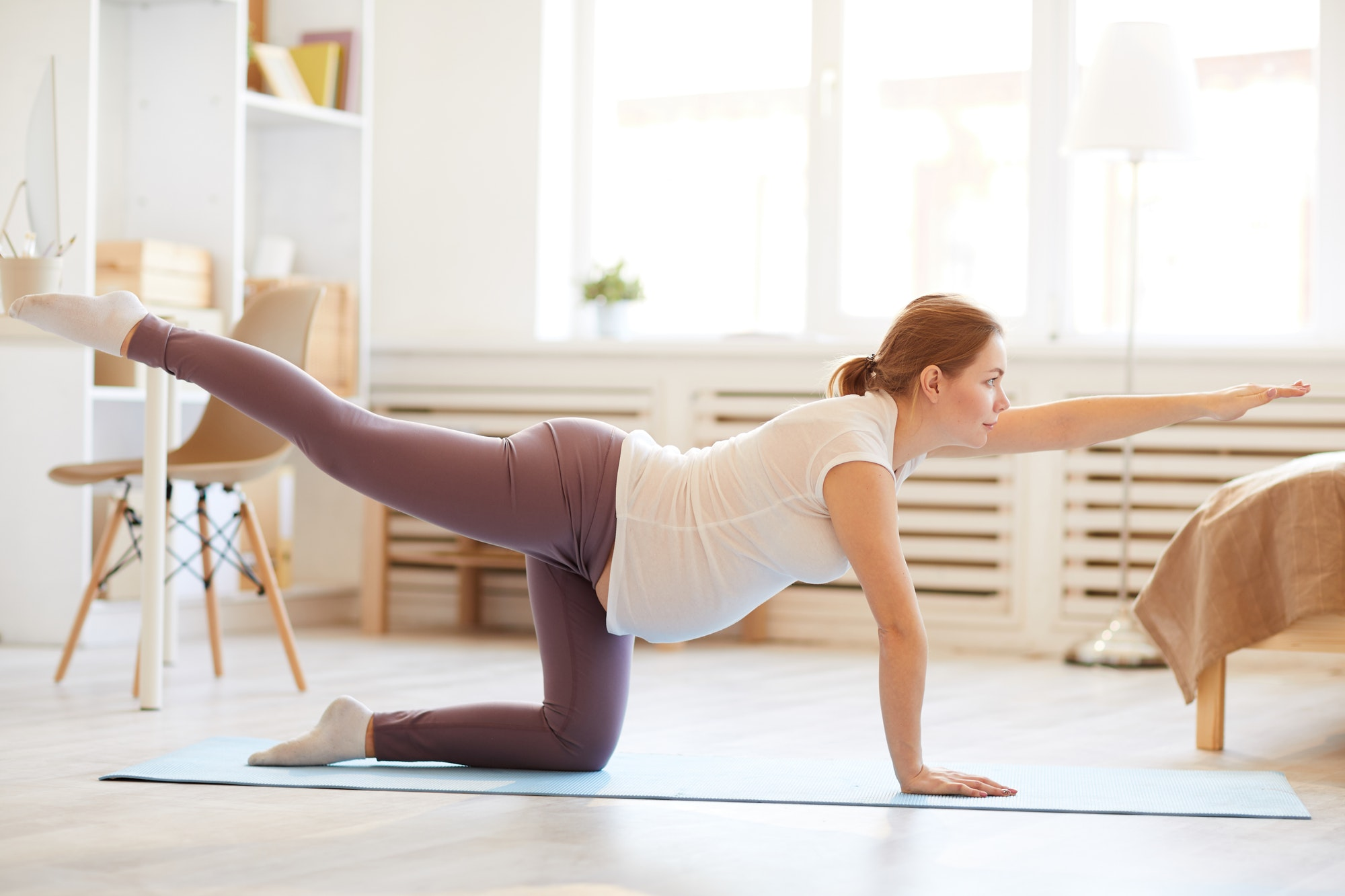 Pregnant Woman doing Stretching Exercises